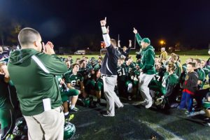 Grafton players and coaches celebrate their victory after the game.