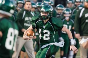 Grafton quarterback Matthew Holbrook carries the ball downfield.