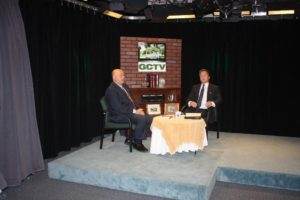 GCTV's Bob DeToma (left) interviews Greg White of the State Office of Consumer Affairs and  Business Regulation. (Photo/submitted)
