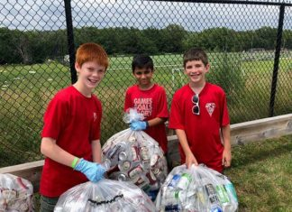 Scouts from Troop 107 sort donated bottles and cans during a summer bottle drive. Photo/Nick Frank.