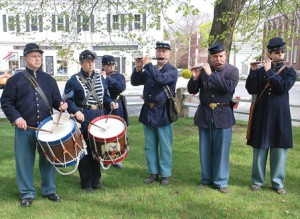 A fife and drum troupe plays circa-1860s music.
