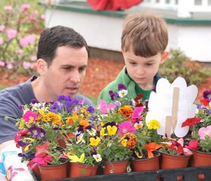 George Webber helps his son Geo, 4, pick a Mother's Day gift.