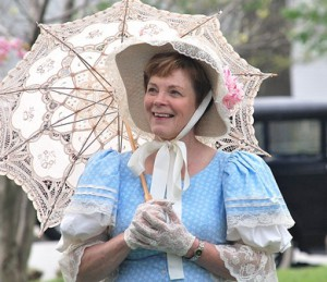 Linda Casey, director of the Grafton Historical Society Museum, mingles wearing Victorian attire.