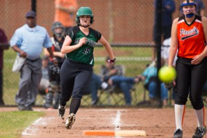 Grafton's Erin Cardoza rounds first base as she watches the ball sail down the right field.  Cardoza ended up with a double on the play.