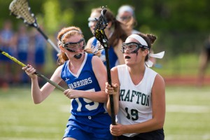 Grafton's Lauren Lyver is bumped by Wahconah's Hannah Ronayne as she looks to pass.
