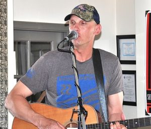 "Pete Towler performs at the ""Singing for Sofia"" fundraiser. Photo/Ed Karvoski Jr."