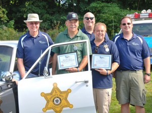 Gathered at a 1968 Plymouth Fury cruiser from Plymouth County are (front, l to r) John Crawford, vice present of the Massachusetts State Police Museum and Learning Center (MSPMLC); Chris Bitteker and John Tassinari Jr., board members of Cops for Kids with Cancer; (back, l to r) Mike Slepetz, MSPMLC fleet historian; and Phil Masso, MSPMLC assistant fleet historian.