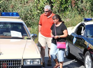 Greg and Kristine Galeota check out a 1989 Chevy Caprice cruiser of the Maryland State Police.