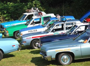 Some of the 28 cruisers from stations nationwide on display during the first Vintage Police Vehicle Show at the Massachusetts State Police Museum and Learning Center.