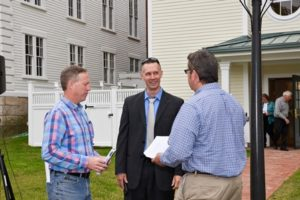 Town Manager Timothy McInerney (center) talks with Andy Deschenes, owner's project manager (l), and Paul Scarlett, Apple Tree's president of the board of directors (r ).