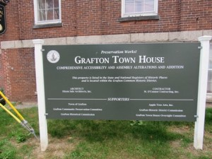 The sign outside the buildings gives details on the project's team.