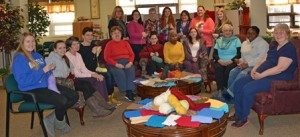 Seniors and students have joined together in Grafton to make afghans to warm up their community. Photo/Joyce DeWallace