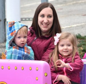 Riding on the Polar Express trackless train ride at UniBank are Katrina Scully with her children Aidan, 10 months, and Aria, 3.