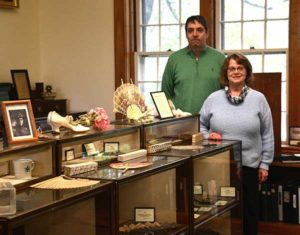 Grafton Historical Society board member Kevin Powers and President Nancy Therrien display artifacts at the new museum location. Photos/Ed Karvoski Jr.