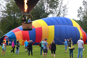 "The ""Celtic Magic"" balloon ascends while ""Equinox"" gets inflated Aug. 19 morning. Photos/Ed Karvoski Jr."