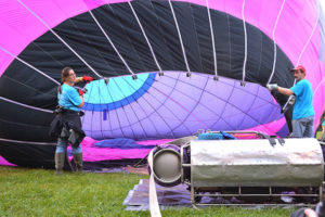 "Crew members help inflate the ""Indecision"" balloon"" Aug. 18 morning. Photos/Ed Karvoski Jr."