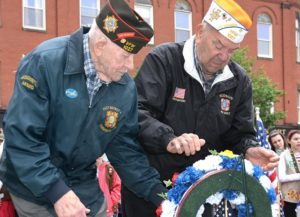 VFW Post 1027 Commander Gene Hakala and Past Commander Joe Duca lay a wreath in Liberty Park at Wood Square. Photos/Ed Karvoski Jr.