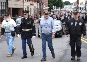 Local veterans (l to r) Rick Giroux, Dick Bonazzoli, Tom McCoy and Bill Higgins march on Main Street.