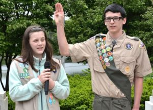 Reciting the Pledge of Allegiance are the Madden siblings – Keria, 12, of Girl Scout Troop 75302, and Connor, 14 of Boy Scout Troop 77.