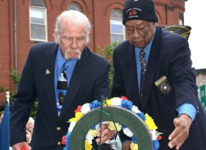 Laying a wreath on behalf of Hudson-Concord Elks Lodge 959 are Past Exalted Ruler Gene Johnson and Exalted Ruler Jesse Harvey.