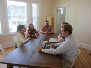 A team meets in one of the bright, airy co-working spaces.