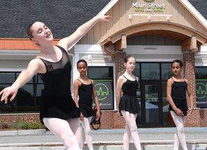 Metrowest Ballet dancers perform in the Main Street Bank parking lot. Photos/Ed Karvoski Jr.