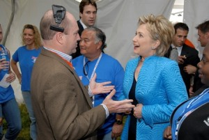 Patrick Halley confers with Hillary Clinton during a convention while he was serving as her principal advance man .  (Photo Courtesy of Bill Burke, Page One Photography, Inc.)