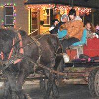 A horse-drawn hayride passes Hudson AMVETS Post 208 on South Street. Photos/Ed Karvoski Jr.