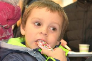 Jaxon Bastis, 5, samples the cookie that he decorated at Wright Jewelry.