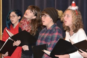 Hudson High students of the a cappella group Camerata perform at Town Hall.