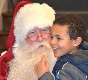 Santa Claus meets A.J. Wade, 5, in the Hudson Town Hall lobby.
