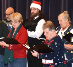 River's Edge Chorale vocalists perform at the Town Hall.