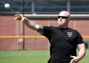Officer Jesse Hayden throws the first pitch.