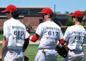 Hudson High School varsity baseball team players sport the T-shirts they sold to benefit the One Fund Boston.