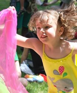 Emma Aostinho, 4, twirls with colorful scarfs.