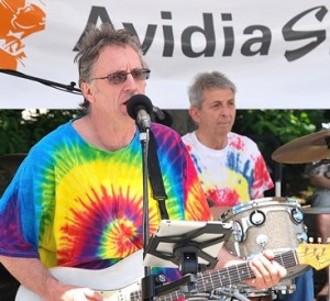 Members of the Workingman's Band perform a Woodstock 45th-anniversary tribute at the Avidia Stage, sponsored by Avidia Bank.