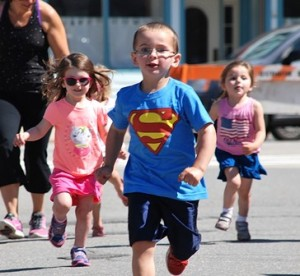 Kids in the 3-year-old division run the Mighty Marathon.