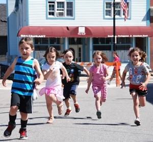 Five-year-old kids race in the Mighty Marathon.