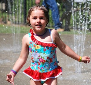 Evelyn DeLand, 4, plays in the Splash Pad.