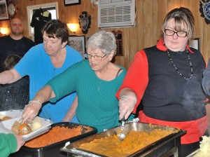 (l to r) Jean Spencer, Past Commander Sue Conrad and Heidi Spencer serve vegetables.
