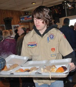 Dan Milton, 17, of Boy Scout Troop 77, reaches the end of the assembly line.