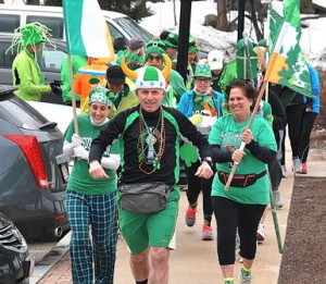 Leading the annual St. Patrick's Day Fun Run out of the Finnegan's Pub parking lot are Jim McKenna, HCS president (center), with flag-bearers Jean Clark and Annette Fillion.