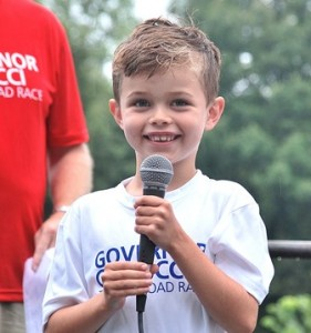 Paul and Jan Cellucci's grandson, Rhys Adams, 7, announces the start of the race.