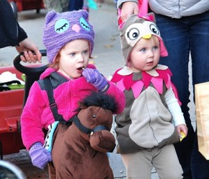 Waiting in line for their next treat are Ava Wagoner, 2, costumed as a horseback rider, and Samantha Cummings, 21 months, as an owl.