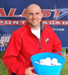 Clint Clark, owner of All Star Sports Academy in Marlborough, offers festival guest stress balls.