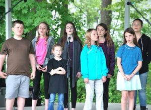 """Young members of the River's Edge Players sing a number from their summer musical """"Oliver!"""""""