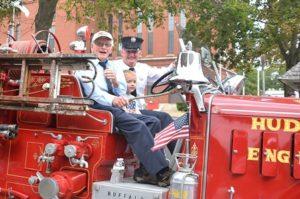 A vintage Hudson fire engine passes Town Hall. Photo/Ed Karvoski Jr.