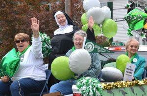"Riding the Hudson Catholic High (HCH) alumni float from the class of 1972 are (l to r) Barbara Nunes, ""Sister"" Linda Winin and Pat Kuras with Mary Hazeldine, a 1947 alum of St. Michael's Academy, the HCH forerunner. Photo/Ed Karvoski Jr."