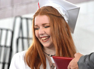 Jacqueline DeProfio reacts to cheers while receiving her diploma. Photo/Ed Karvoski Jr.