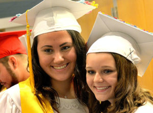 A classmate photographs Meghan Collins and Leah Chagnon prior to the graduation ceremony. Photo/Ed Karvoski Jr.